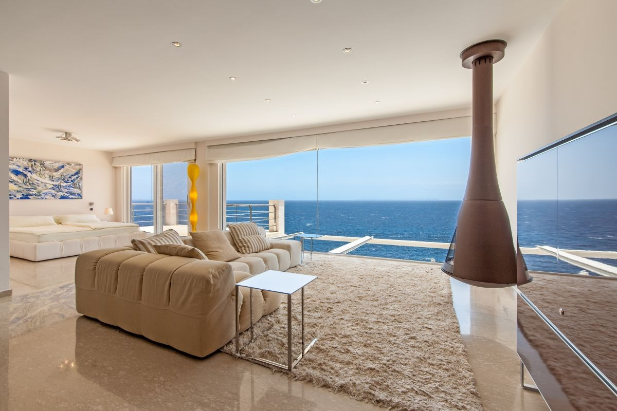 High quality villa in minimalist style on the 1st sea line in Cala ...